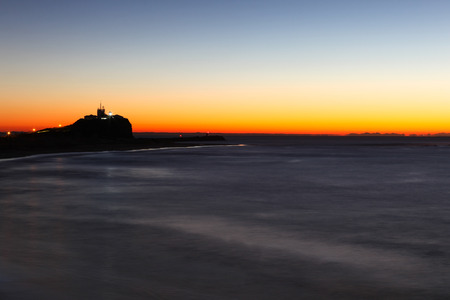Nobbys lighthouse and beach at dawn. This headline and lighthouse is one of Newcastle most famous landmarks