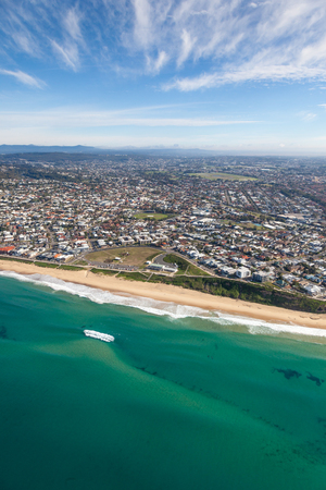 An aerial view of Dixon Park and Merewether Beach in Newcastle NSW Australia. The suburbs of Bar Beach Merewether and Cooks Hill are popular residential areas adjacent to this stretch of coast. Newcastle New South Wales Australia Stock Photo - 119655996