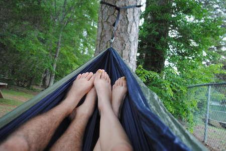 Couple relaxing in hammock Reklamní fotografie