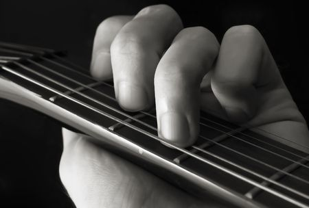chord: Hand forming chord on guitar