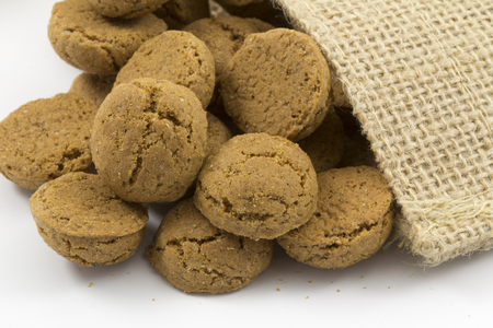 zwarte: A closeup of a bunch of pepernoten in a jute bag, a traditional dutch treat with sinterklaas on the 5th of december. Stock Photo