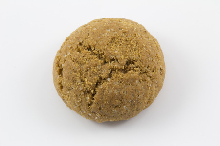 zwarte: A single pepernoot, a dutch traditional treat on the 5th of december, isolated on a white background.