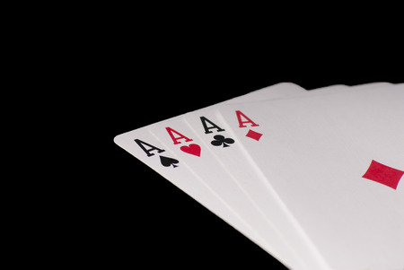 aces: Poker aces in black background macro  photo Stock Photo