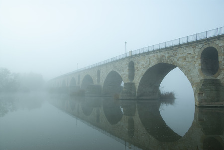 City in the fog romanesque bridge Zamora Stock Photo