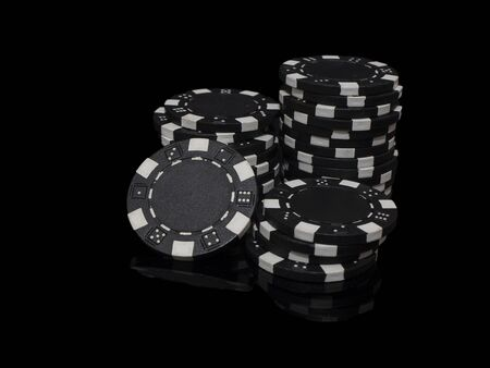 Stacks of poker chips isolated on black background Stock fotó