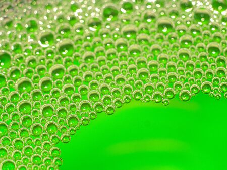 Neon green liquid pumps. Abstract background