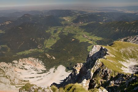 schneeberg: rocks of the schneeberg hill with the view of the valley, alps. austria