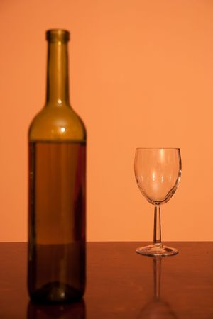 bottle with empty glass - alcohol addiction concept photo