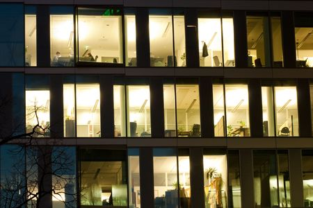 detail of office building windows with lights on Stock Photo - 5975938