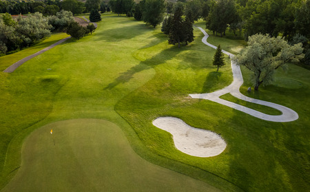 golf course: Aerial view of a beautiful green golf course.