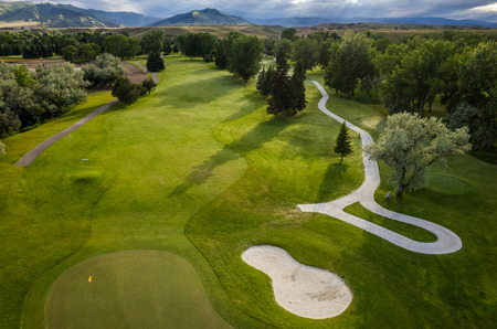 fairway: Aerial view of a beautiful green golf course.