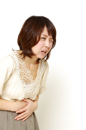 fart: woman suffers from stomachache