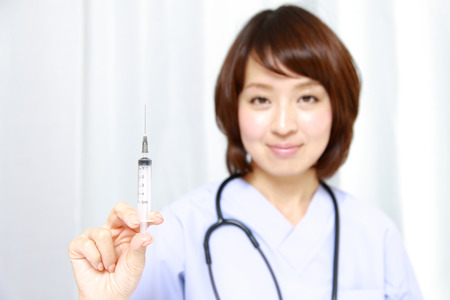 injector: Japanese Female Doctor With injector