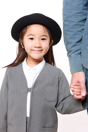 Japanese kindergartener walking to kindergarten with her father