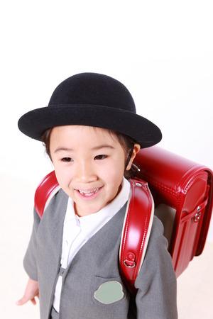 Japanese Schoolgirl With Red Satchel Smiles photo