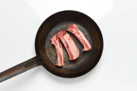 spareribs in a frying pan photo