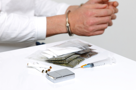 drug dealer: arrested drug dealer Stock Photo