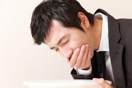 vomiting: vomiting businessman