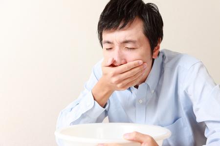 vomiting man