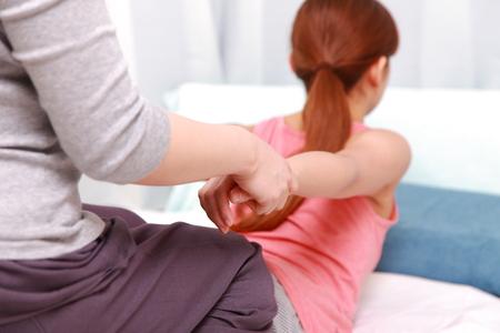 thai massage: Woman Getting Thai Massage