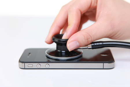 handphones: smartphone examined with a stethoscope