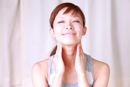 young Japanese woman doing a lymph node massage  photo