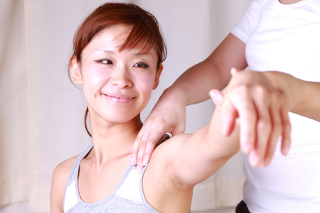 chiropractic: young Japanese woman getting chiropractic Stock Photo