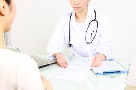 doctor talks to her patient