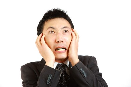 Frightened Japanese businessman