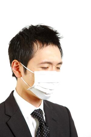 unhealthiness: Japanese businessman with mask  Stock Photo