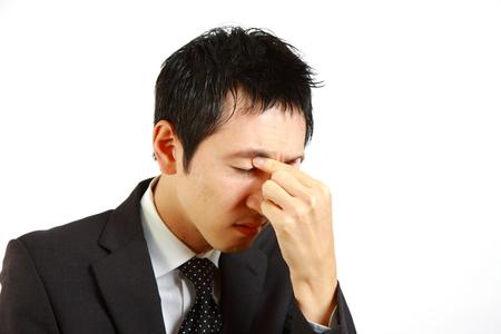 eyestrain: Japanese businessman suffer from a eyestrain