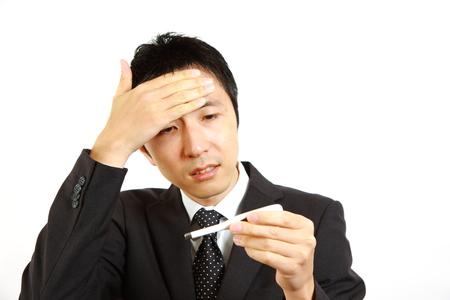 unhealthiness: Japanese businessman having fever