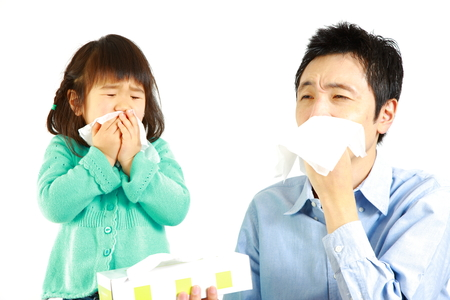 sneezing father and daughter