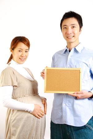 pregnant couple with massage board  photo