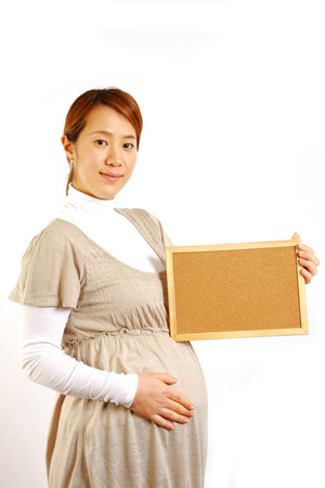 pregnant woman with massage board   photo