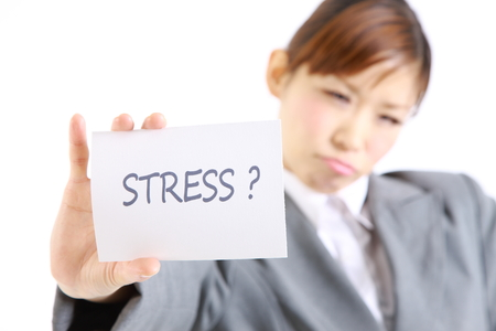 ploblem: businesswoman showing a card with word \stress?\ Stock Photo