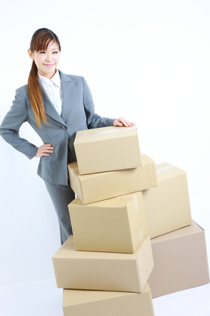 buisiness: buisiness woman with Cardboard boxes