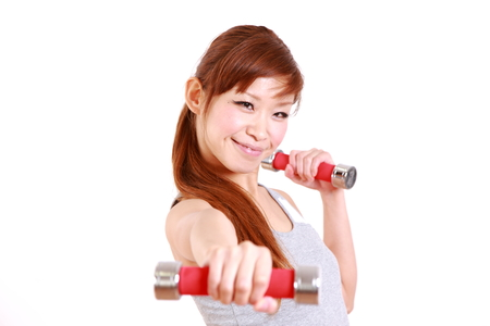young Japanese woman with dumbbell exercises 版權商用圖片