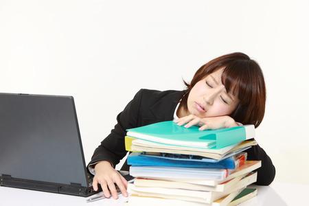 businesswoman Sleeping on the desk photo
