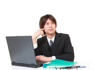 Japanese businessman dreaming at his future photo
