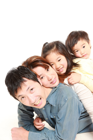 japanese woman: Japanese Family Of Four Stock Photo