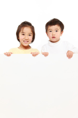 children with a white board photo