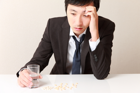 neurosis: businessman suffers from a neurosis Stock Photo