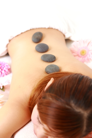 woman getting stone therapy photo