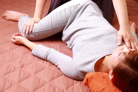 Woman Getting Thai Massage