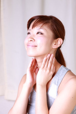 young woman doing self neck massage
