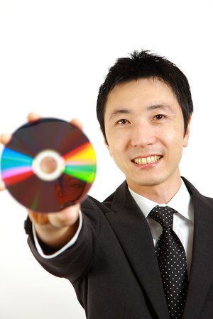 buisiness: Japanese businessman showing a media disc
