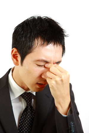 unhealthiness: Japanese businessman suffer from a eyestrain