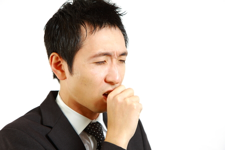 unhealthiness: Japanese businessman suffer from a bad cough