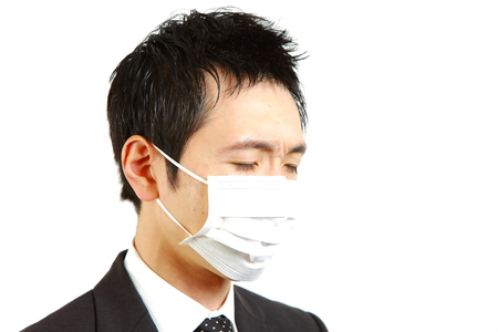 unhealthiness: Japanese businessman with mask